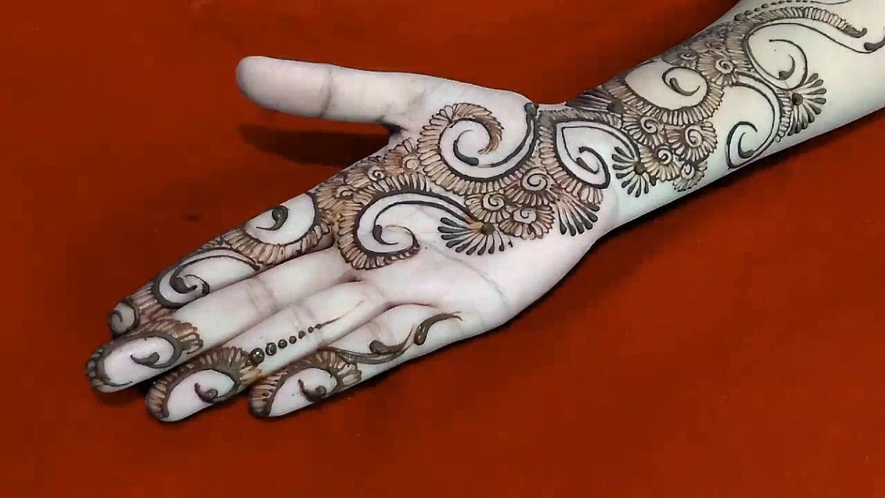 Arm Mehndi Style : Modern style full hand mehndi design with orange glitter for all