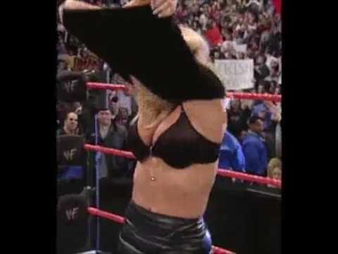 Hot WWE diva Trish Stratus opening her clothes thumbnail