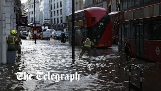 video: Flooding causes travel chaos in London as Tube and roads forced to close