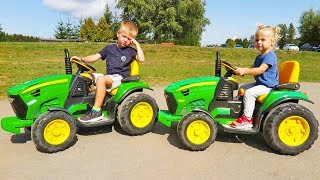 Outdoor Activity with John Deere Tractors at the Amusement Park with Elis and Thomas Toys