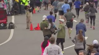 The heartwarming moment two men stop to help a woman finish her half marathon