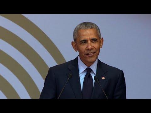 Obama warns of 'strange and uncertain times' in Mandela tribute