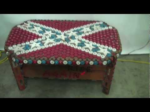 "Art & Antiques Collection - Table of bottle caps inscribed ""The South Will Rise Again"""