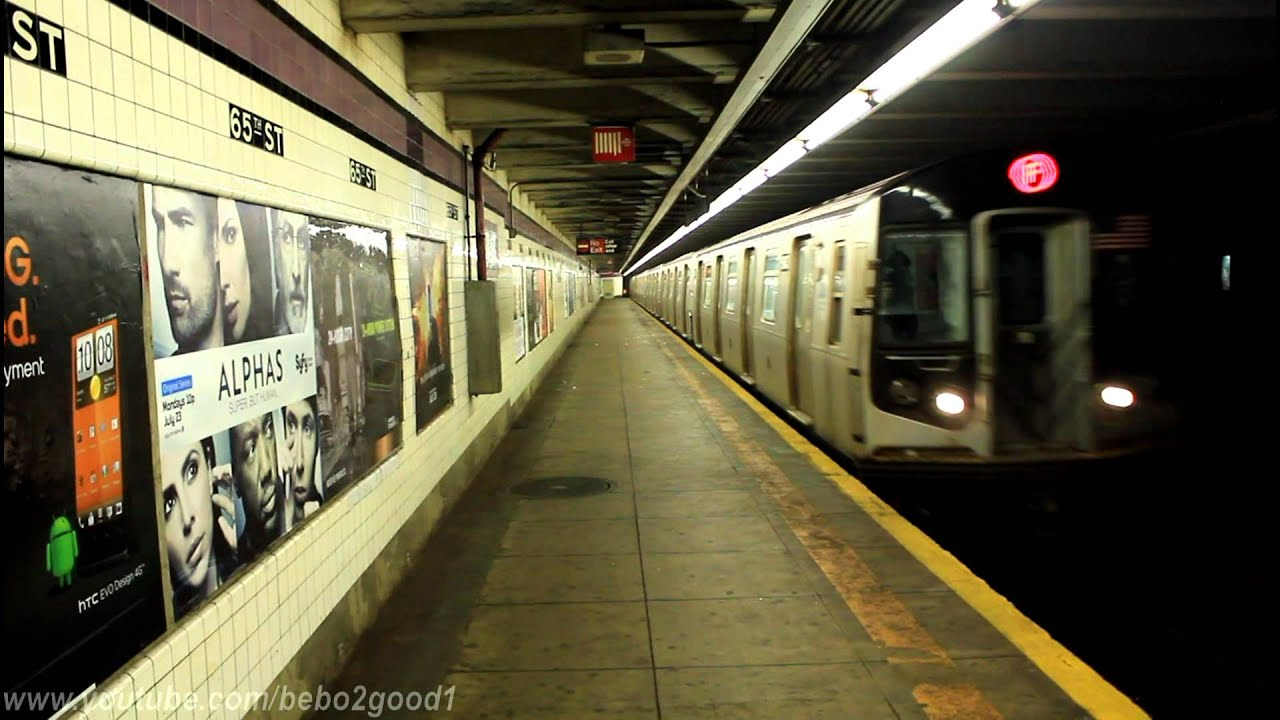IND Subway Jamaica And Continental Ave Bound E F R Trains At 65th St R46 R160