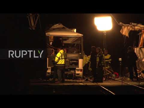 France: Emergency services work through wreckage of fatal bus-train collision in Perpignan