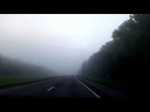 Sunrise and fog on a highway 20140824 063222