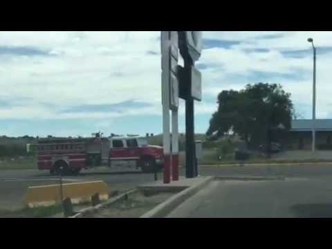 San Miguel County, New Mexico Fire Department engine company passing by