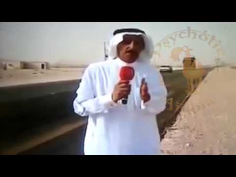 Fast truck passes by a Saudi TV reporter