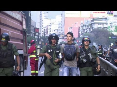 Clashes and arrests as anti-Maduro protests continue in Caracas