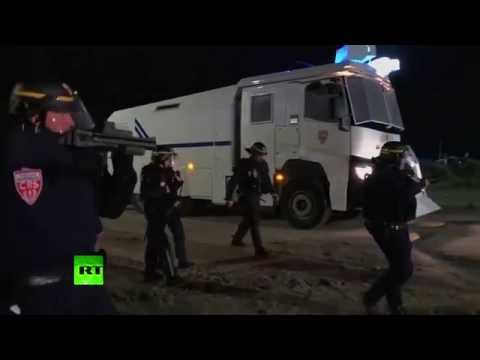 French police clash with migrants at Calais camp 'the Jungle'