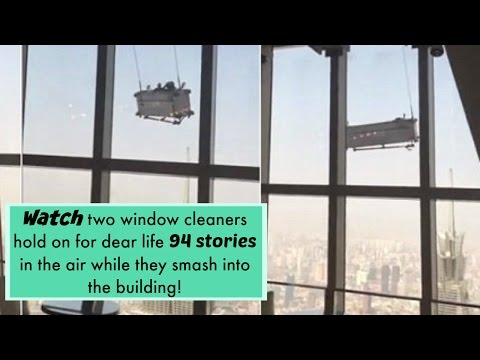 Two window cleaners stuck on a swinging platform on China's 2nd tallest building - News Me!