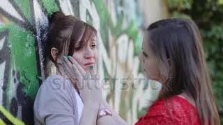 stock footage sad woman crying while hugging a friend color