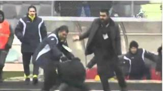 Ankaragucu Manager (Umit Ozat) slugs a pitch invader