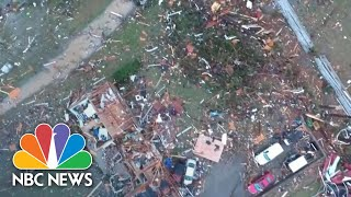 At least 25 people were killed when several tornadoes barreled toward the city, destroying entire neighborhoods and homes. one is believed to have b...