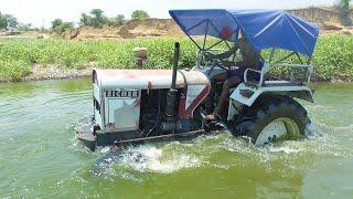 Washing my Eicher 242 Tractor in River