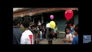 Distributing free balloons on the special 25 Year enthronement celebrations in Bhutan