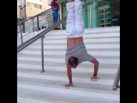 Tari Mannello walking down stairs in handstand