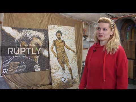 Russia: Artists create Messi and Salah mosaics