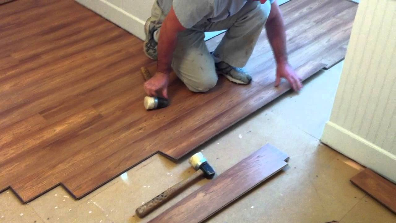 How to install pergo laminate flooring youtube for How to lay laminate flooring through a doorway