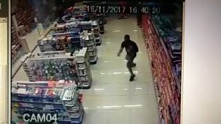 brazilian cop fires at robber with baby in arm