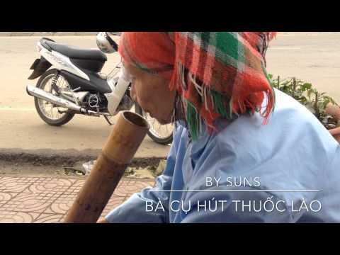 no say ben bản bà già hút thuốc lào :v