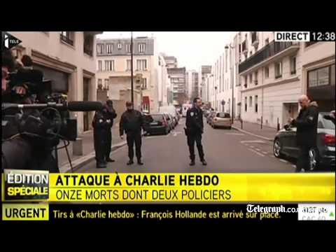 Watch: Charlie Hebdo shooting victims carried from building