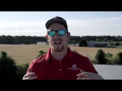 Metal roof damage from hail storm | Ready Roofing