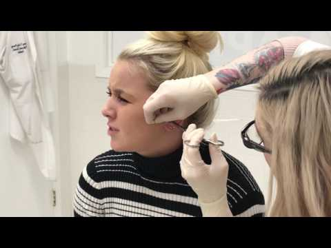 Tragus Piercing - check out her reaction