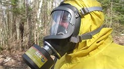 Trail walking in a chemical suit