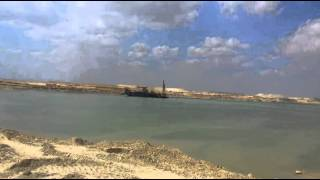 In a scene of drilling and dredging the new Suez Canal March 19, 2015