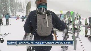 Backpacks pose problem on ski lifts