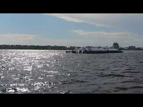 Huge barge passing Port side