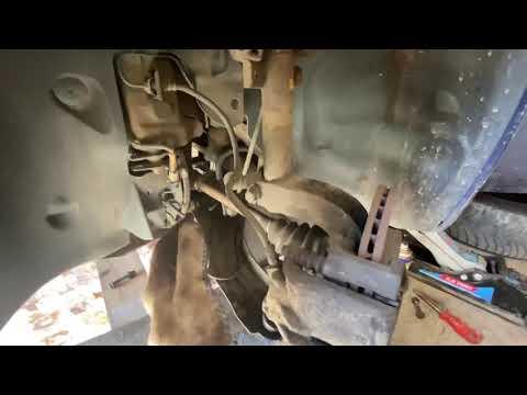 Замена передних тормозных колодок Renault Megane