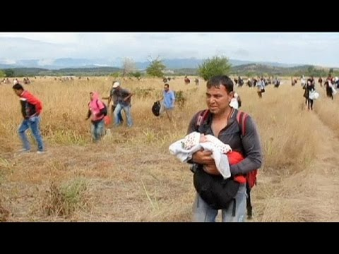 Chaos as migrants overpower police at Greek/FYR Macedonia border - no comment