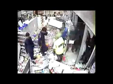 Thugs backed up by police attacking Jawad 24 Hours supermarket HD