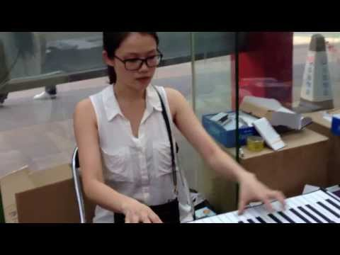 Roll up piano and beautiful artist.
