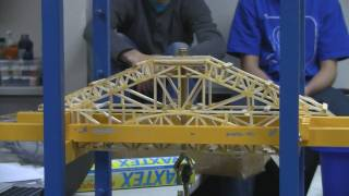 This is a bridge that Michael and I built and tested in our high school engineering class. Overall it had a mass of 85 grams (0.19 lbs)