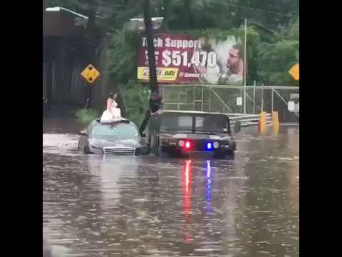 VIDEO: Bogota PD In Humvee Rescue Bride, Groom, Guests Stranded In Rising Floodwaters