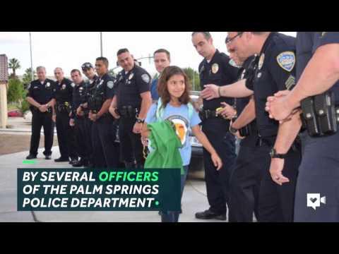 Police escort fallen officer's daughter to school