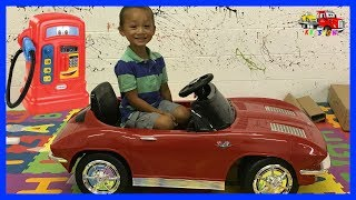 Unboxing Assembling The Powered Ride On Corvette Stingray 12v With Little Tikes Cozy Gas Pumper