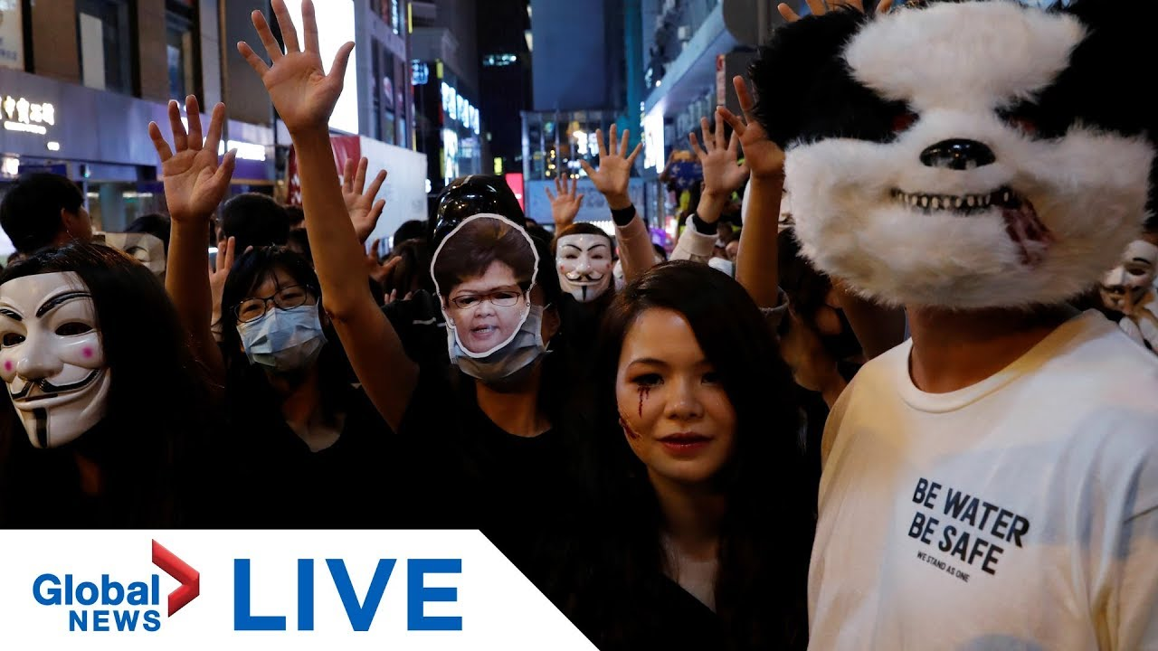 Hong Kong protests: Halloween masquerade march disrupted by police | LIVE