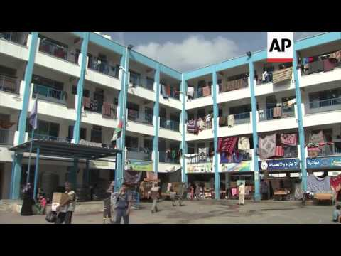 Displaced still at UN school in Gaza as ceasefire takes hold; scenes of destruction elsewhere; Israe