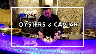 Chef Grégorie Berger prepares Oysters with Seaweed foam and Caviar at Ossiano Restaurant in Dubai