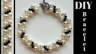 Pearl bracelet making.  How to make white and black bracelet.  Beading tutorial- very easy