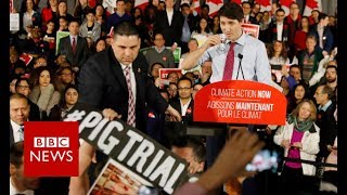 Trudeau heckled at climate change address - BBC News