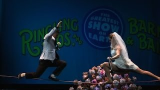 Circus Acrobats Tie the Knot on Tightrope