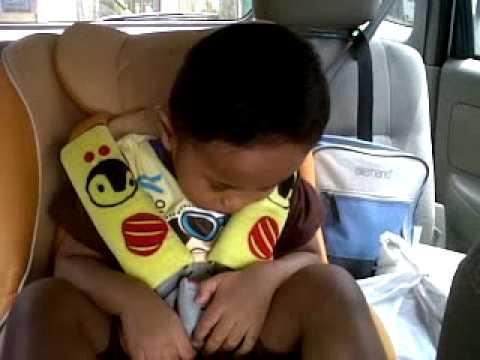 Cute sleeping baby in car hear a song