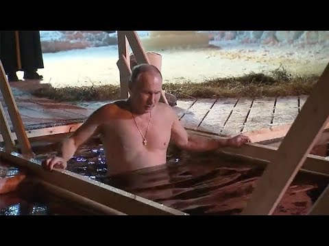 Putin braves icy water for traditional Epiphany dip