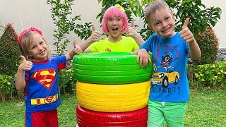 색깔있는 바퀴를 가지고 놀다 Alex and Nastya play with colored wheels