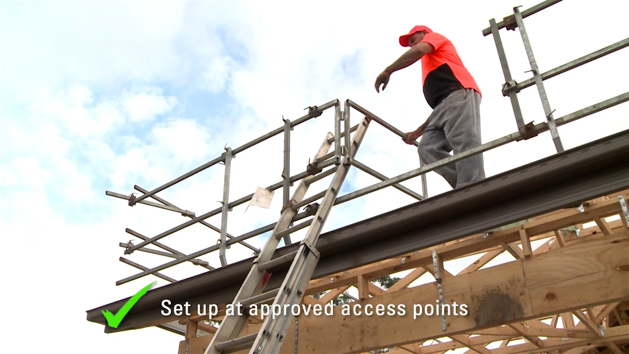 how to use a ladder to get on a roof